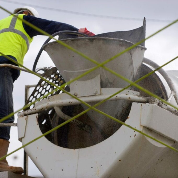man operating the cement mixer