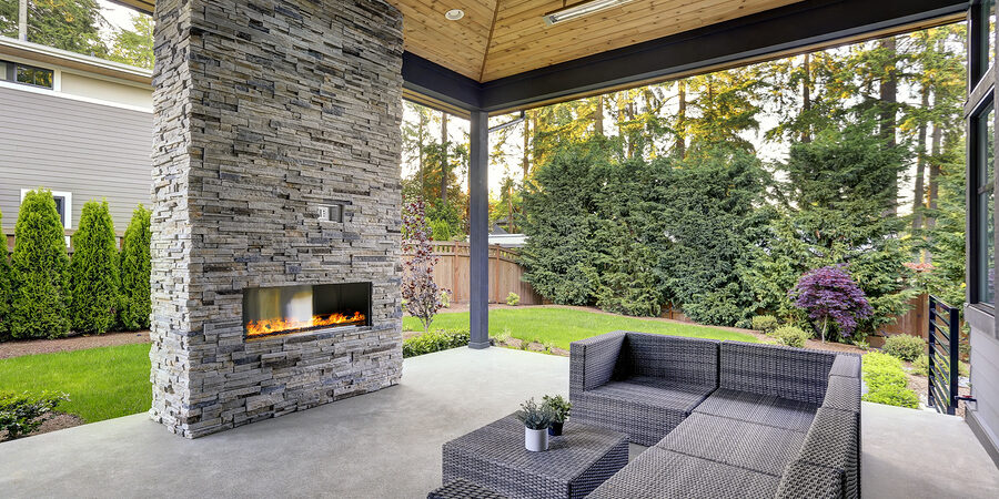 New modern home features a backyard with covered patio
