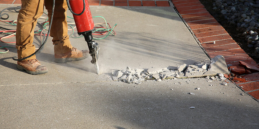 An old Cement Drive Way being demolished to be rebuilt