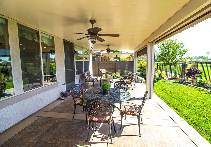 Rear Yard Covered Patio With Table And Chairs